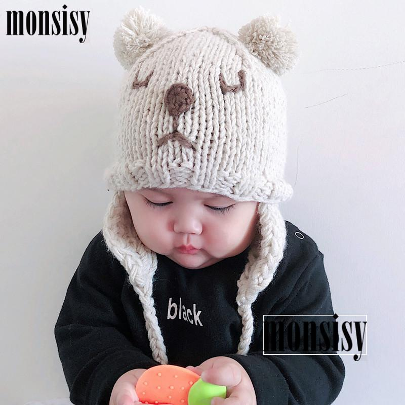 ecb322497 Monsisy Winter Baby Earmuffs Hat For Boys Girls Cap Kids Warm Wool Knitted  Beanie Newborn Ball Cap Cute Infant Bear Skullies