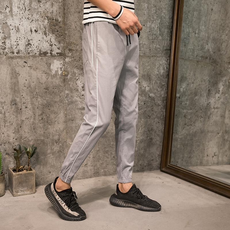 1c9f1950d4dd 2019 Casual Male Korean Version Of The Trend Of Summer 2018 Thin Section  Pants Beam Foot Harem Pants Loose Elastic Nine Points From Yangfan515