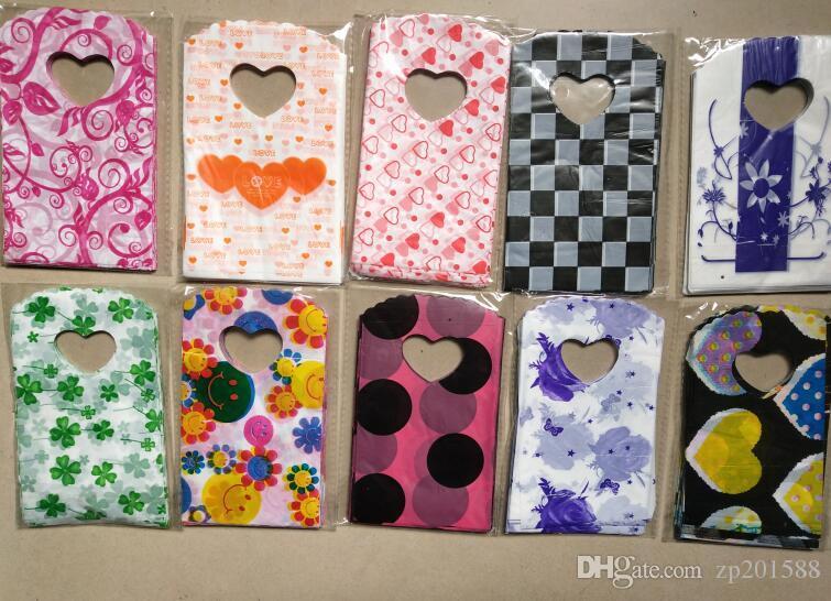 / 15X9cm sacchetti di gioielli cuore fiori modelli sacchetto di plastica sacchetti di gioielli sacchetti di stile misto imballaggio degli accessori