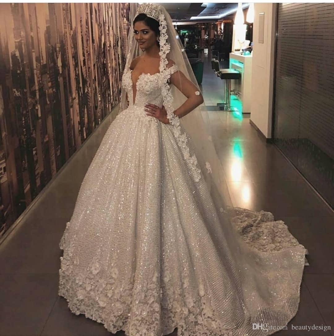 c56929ac8c35 Discount 2019 Vintage A Line Lace Wedding Dress Arabic Style Appliques Off  The Shoulder Sheer Sleeveless Wedding Dress With Long Train Bridal Gowns  Cream ...