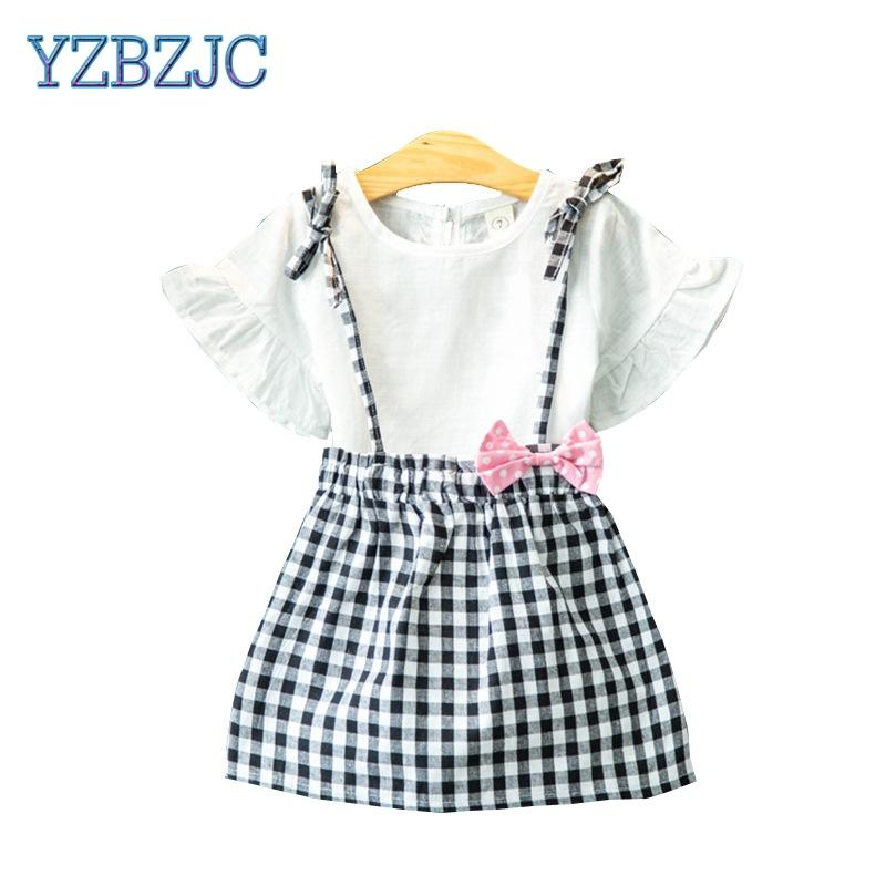 c328b9591d4 2019 2018 Children Girls Summer Trumpet Short Sleeved T Shirt + Plaid Strap  Skirts Clothes Two Piece Suit Kids Girls Fashion Sets From Sophine13