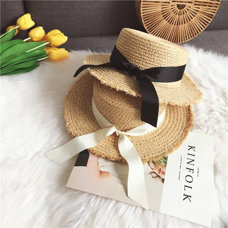 Luna Dolphin Women Summer Beach Raffia Black White Ribbon Hat Bow Raffia Hat  Temperament Flat Straw Hats Women S Sea Beach Hat D18103006 Fascinator Hats  ... a445f50a461