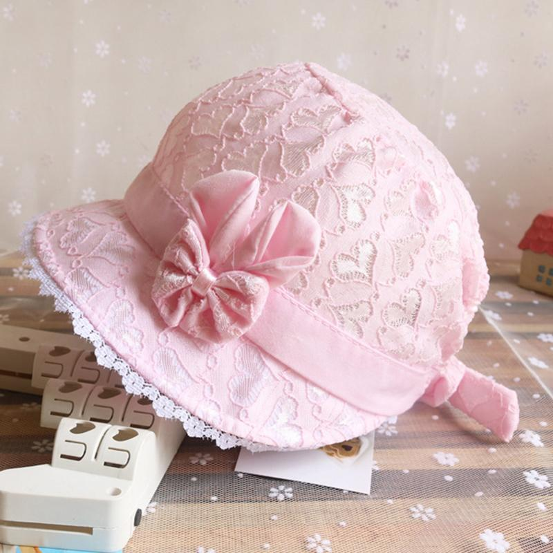 7dd40d5588e 2019 Summer Cute Princess Baby Hat With Bow Solid Color Lace Hollow Baby  Girl Cap Toddler Kids Beach Bucket Hats From Fkansis