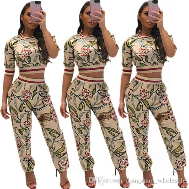 59314a9f9e3a 2019 New Floral Printed Sexy Set Women O Neck Short Sleeve Crop Top And  Casual Ankle Tied Pants Summer Streetwear From Dongguan_wholesale, $17.77    DHgate.