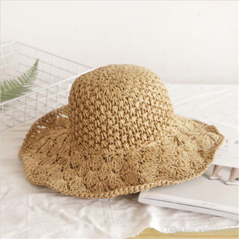 c9d1587c6 Handmade crochet straw hat ladies along the hollow sunshade collapsible  sunscreen big sun beach wide-brimmed hat travel cap