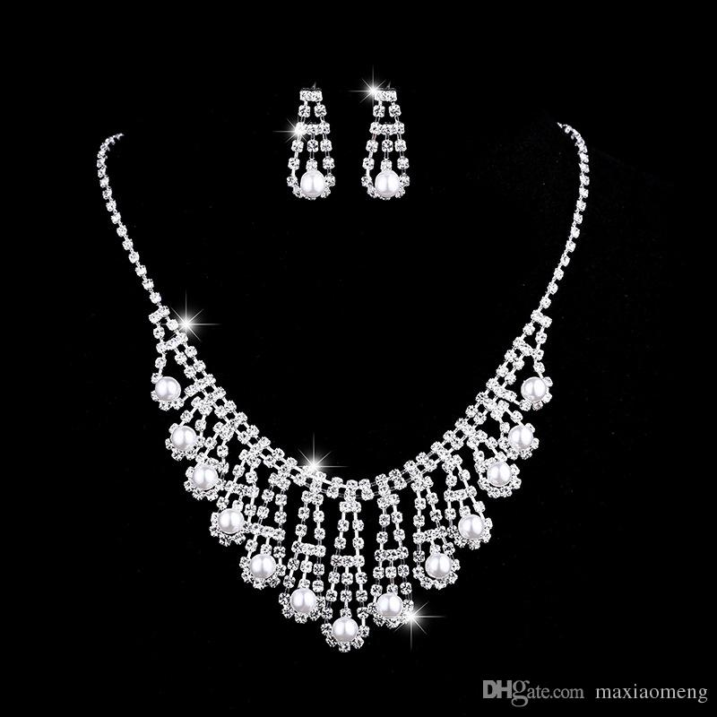 4cbe5568707e Inlaid Austria Crystal Pearl Bridal Necklace Earring Suit Made with Swarovski  Crystal Wedding Ornaments Glittering Love Necklace Online with  5.72 Set on  ...