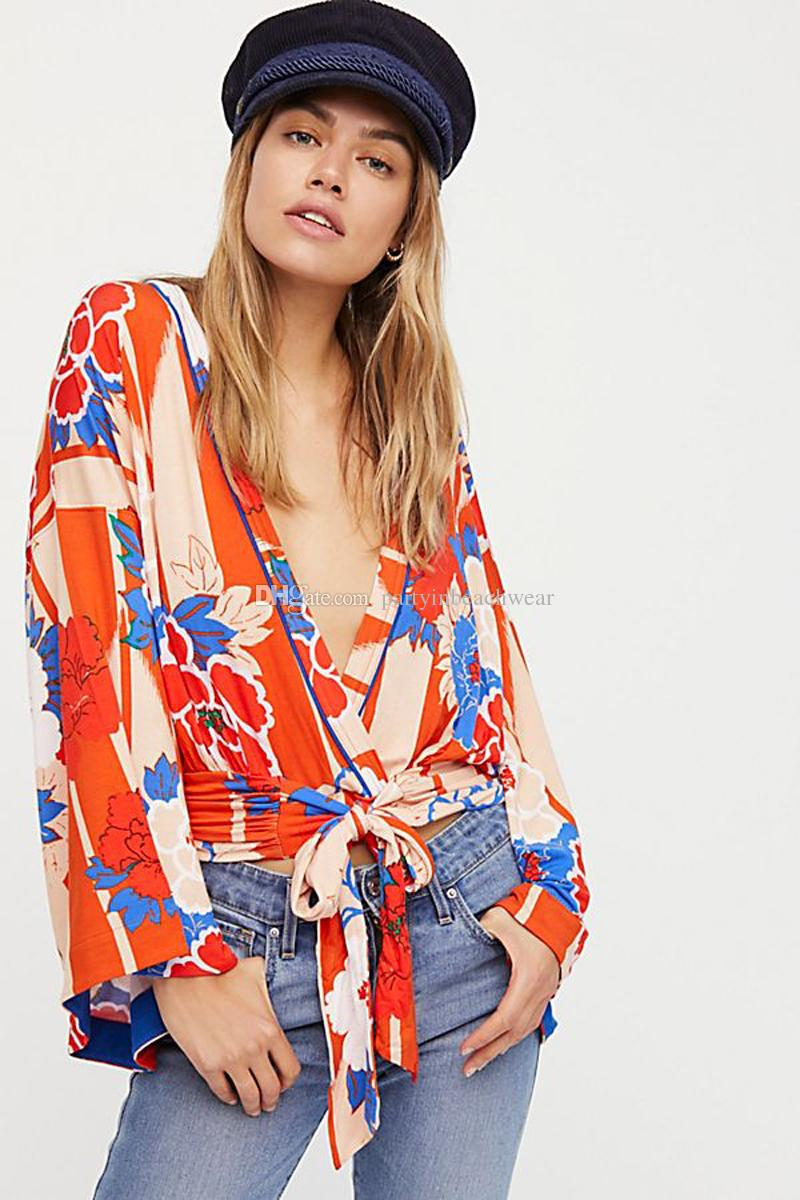 606193e9a27bc 2019 Knitted Boho Blouse Floral Kimono Wrap Print Top New Chic Spring Sexy  V Neck Bow Long Sleeves Bohemia Beach Holiday Short Women Shirts From ...