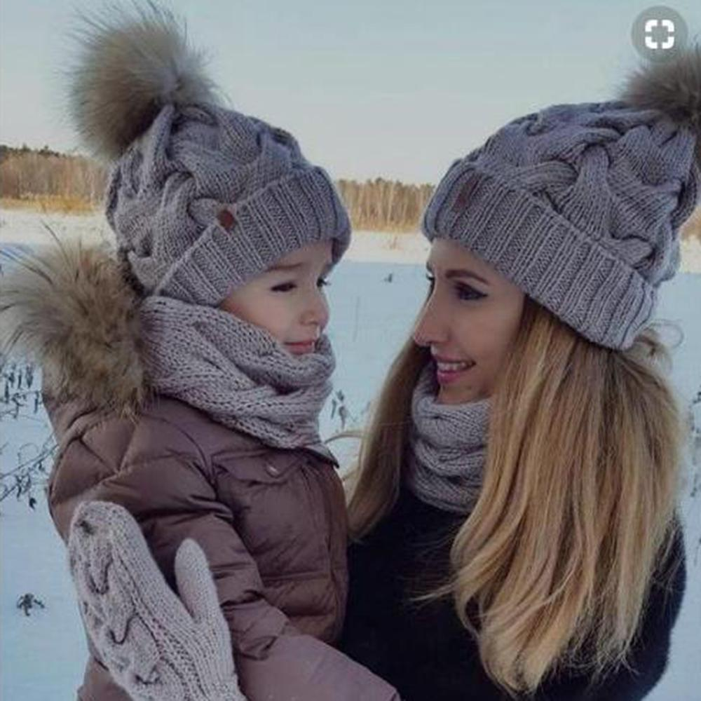 Mom Baby Fur Pompom Hats Warm Winter Crochet Knit Wool Solid Color Beanie  Caps For Women Boys Girls Matching Hats UK 2019 From Pothos 14f35cd231a