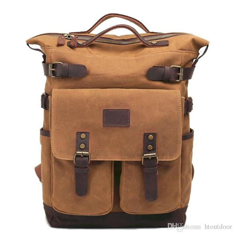 2019 Vintage Leather Canvas Backpack Outdoor Travel Hiking Camping  Weekender Rucksack Casual Daypack College School Bag Business Laptop Bag  From Htoutdoor a86d8e18b6566