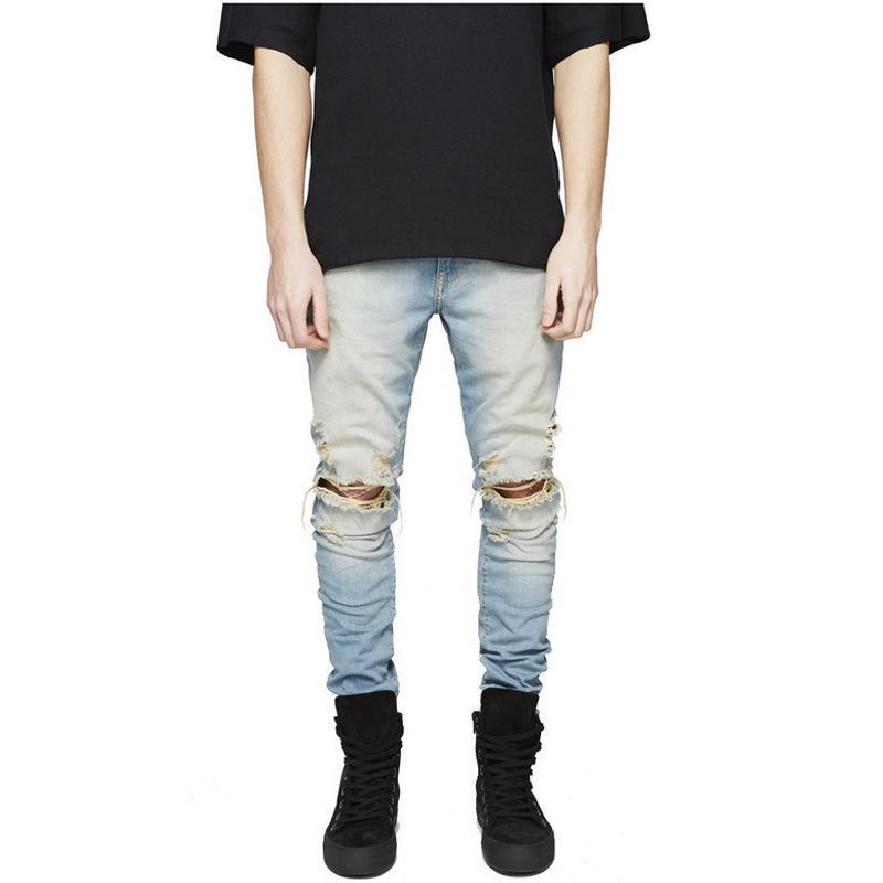 87154bf1d 2018 nuevos hombres negros rasgados de los pantalones vaqueros con los  agujeros Super Skinny diseñador famoso marca slim fit pantalones de Jean ...
