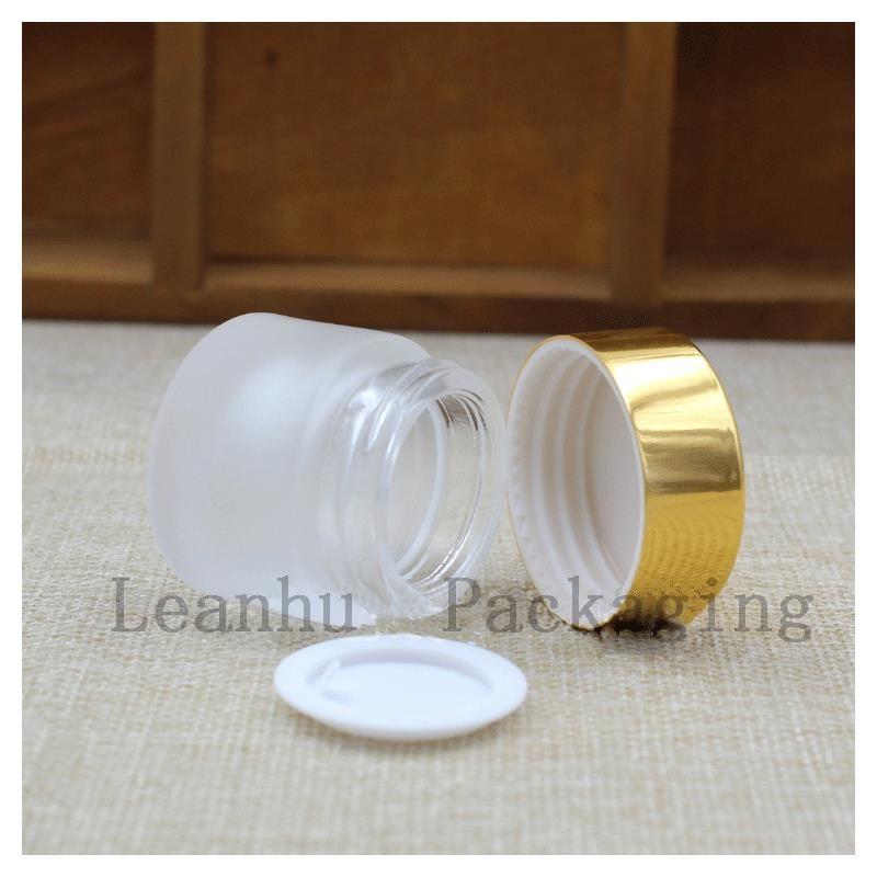 5 g di vasetti di vetro smerigliato con il coperchio della bottiglia di crema cosmetica oro / argento