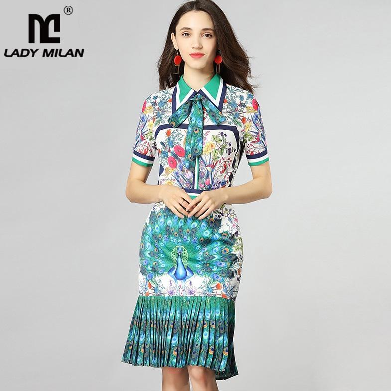a37f031c1 Camisa estampada a rayas con detalle de lazo en las mujeres y falda plisada  de sirena Vestido gemelas de dos piezas en la pista de moda