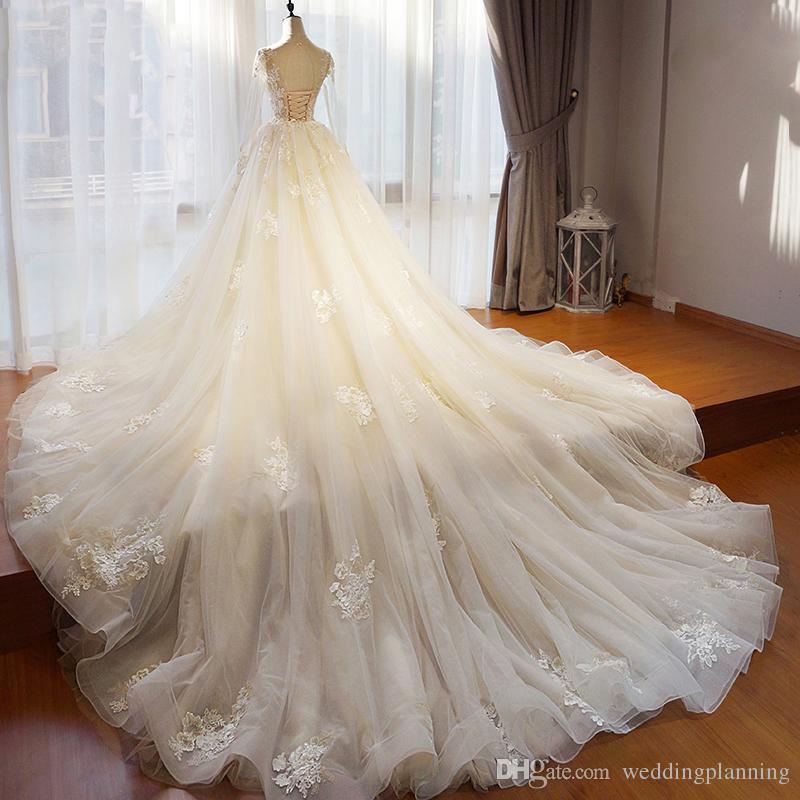 Luz Champagne Ivory Imagen real Vestido de novia Largo Tren extraíble Dobladillo Apliques Manga larga Arabia Saudita Vestidos de novia formal