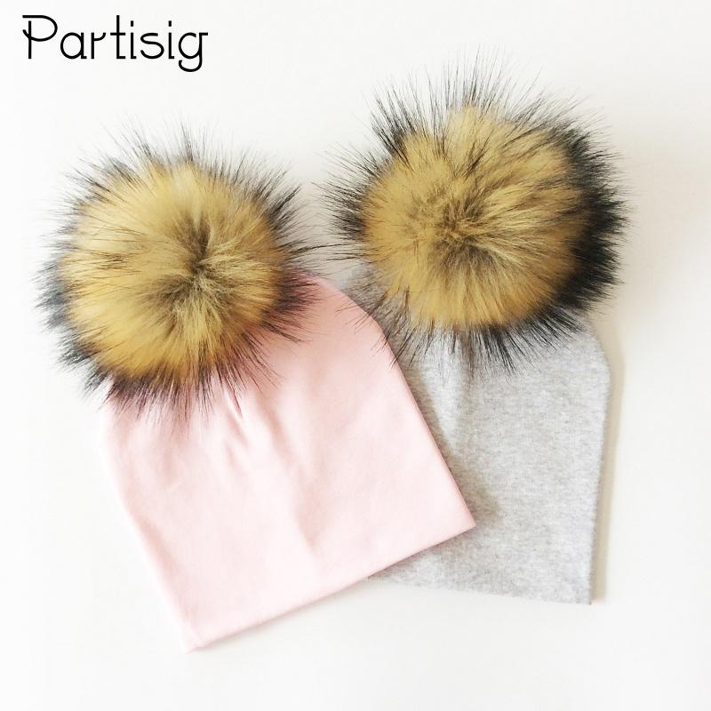 fec9eb468eb 2019 Baby Hat Faux Fur Baby Cap Coon Pompom Bobble Hat For Kids Winter Boys  And Girls Caps Artificial Fur Children s Hats From Fkansis