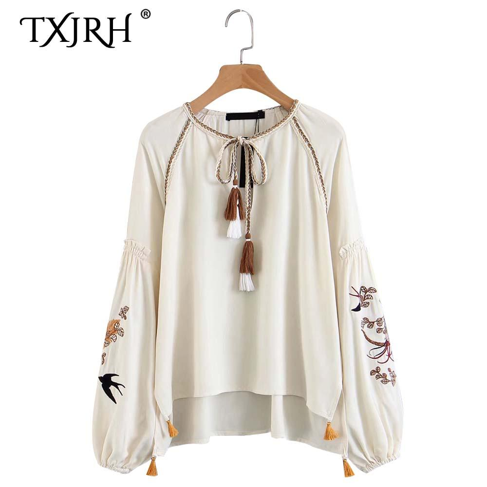 97a750763c4d 2019 TXJRH Stylish Loose Shirt Trendy Long Sleeve O Neck Lacing Up Bow Tassel  Vintage Ethnic Floral Embroidery Blouse HI LO Hem Tops From Piterr, ...