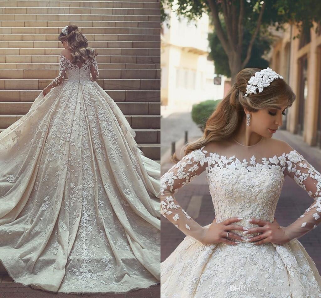 2018 Gorgeous Lace Wedding Dresses Sheer Neck Long train Long Sleeves Crystals Ruffles Appliques Arabic Dubai Wedding Gowns Custom Made