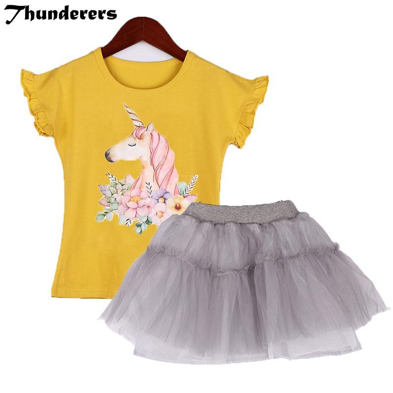 b28055e0c Compre Conjunto Infantil Ropa Para Niñas Conjunto Nuevo Patrón Mágico De Unicornio  Camiseta Amarilla Falda De Encaje Ropa De Niños 3 7Y Niñas Volantes ...