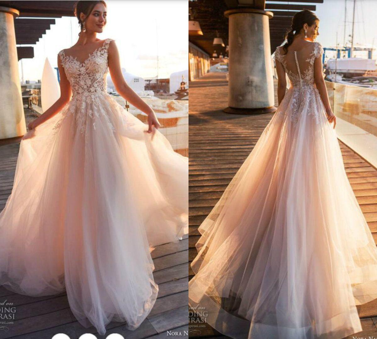 3d27d94744c Discount 2019 Perfect Beach Wedding Dresses A Line V Neck Cape Sleeves Lace  Appliques Boho Bridal Gowns Blush Simple Bohemian Wedding Dress Plus Size  ...