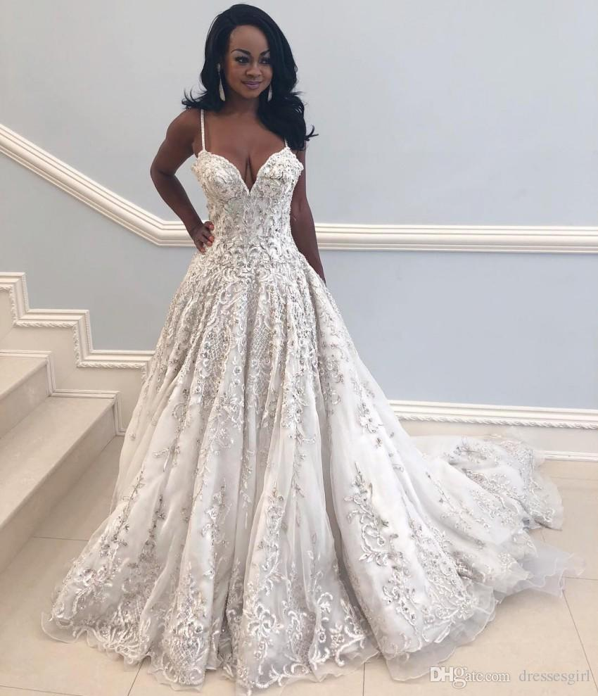 Discount 2019 Newest African Wedding Dresses A Line Spaghetti Straps  Vestidos Sexy Backless Court Train Bridal Gowns Appliqued Fitted Luxury  Vintage Wedding ... 6679a487f