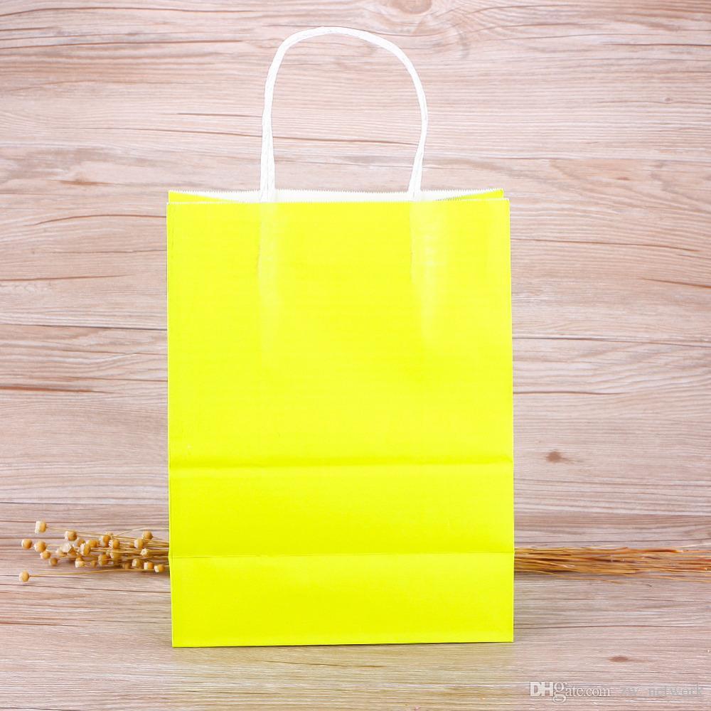 Sacchetto dell'imballaggio della carta kraft di alta qualità con il sacchetto del regalo di festival delle maniglie i colori della caramella di nozze i sacchetti di carta lo shopping i
