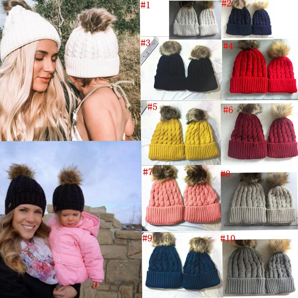 8b8313b72dc 2019 Mother Kids Child Baby Warm Winter Knit Beanie Fur Pom Hat Crochet Ski Cap  Cute 2017 New Arrival Mom And Baby Knited Hats MMA790 From  Liangjingjing no3 ...