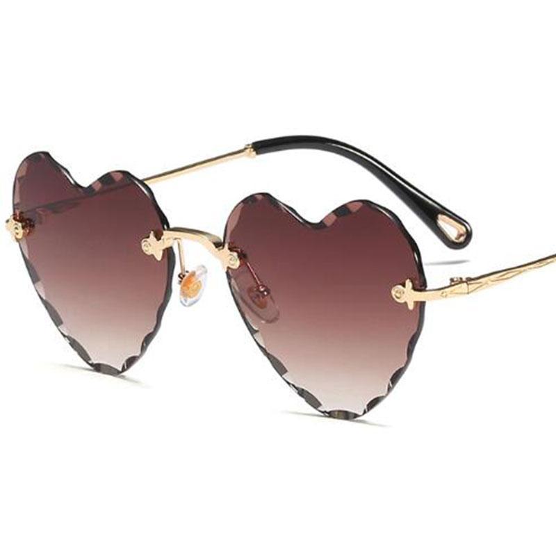Compre Tinted Coração Óculos De Sol Femlae Óculos De Sol Sem Aro Amor Em  Forma De Tons Vintage Para As Mulheres Vermelho Marrom Óculos Marca De  Design 2018 ... 781fc6cf57