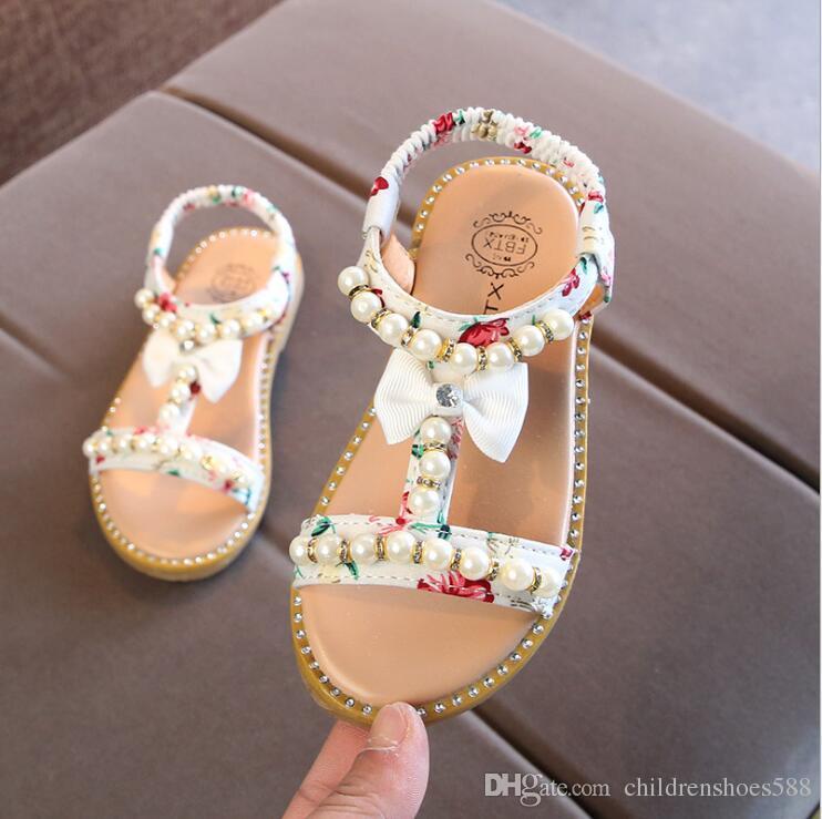 2018 Sommer neue koreanische Kinder Sandalen Mädchen offene Spitze Perle Prinzessin Schuhe kleine Rutsch Babyschuhe