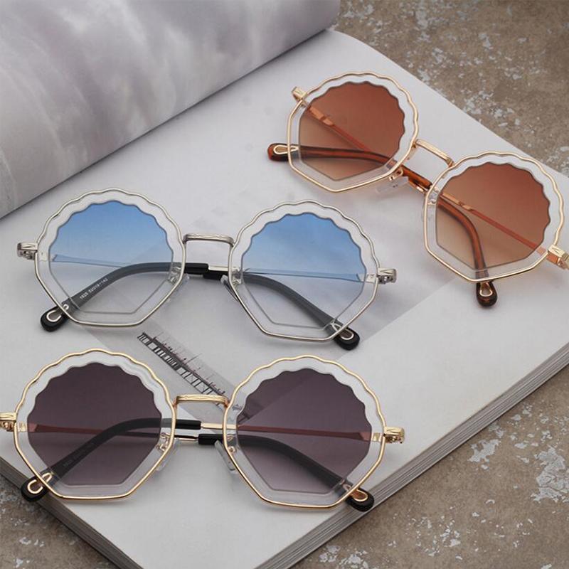 5ddb512648 Compre Flores Irregulares Gafas De Sol Moda De Caramelo Gafas De Sol De  Color Rosa Redondas De Metal Diseñador De La Marca Gafas De Sol Mujer  Diseñador ...