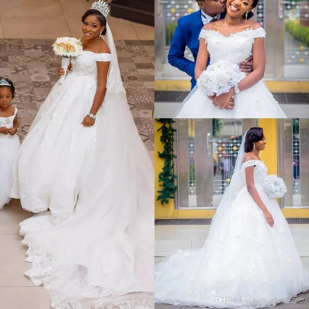 2018 Cheap A Line Wedding Dresses Off Shoulder 3d Flowers Lace Applique Beads Sexy Back With Button Court Train Country African Bridal Gowns