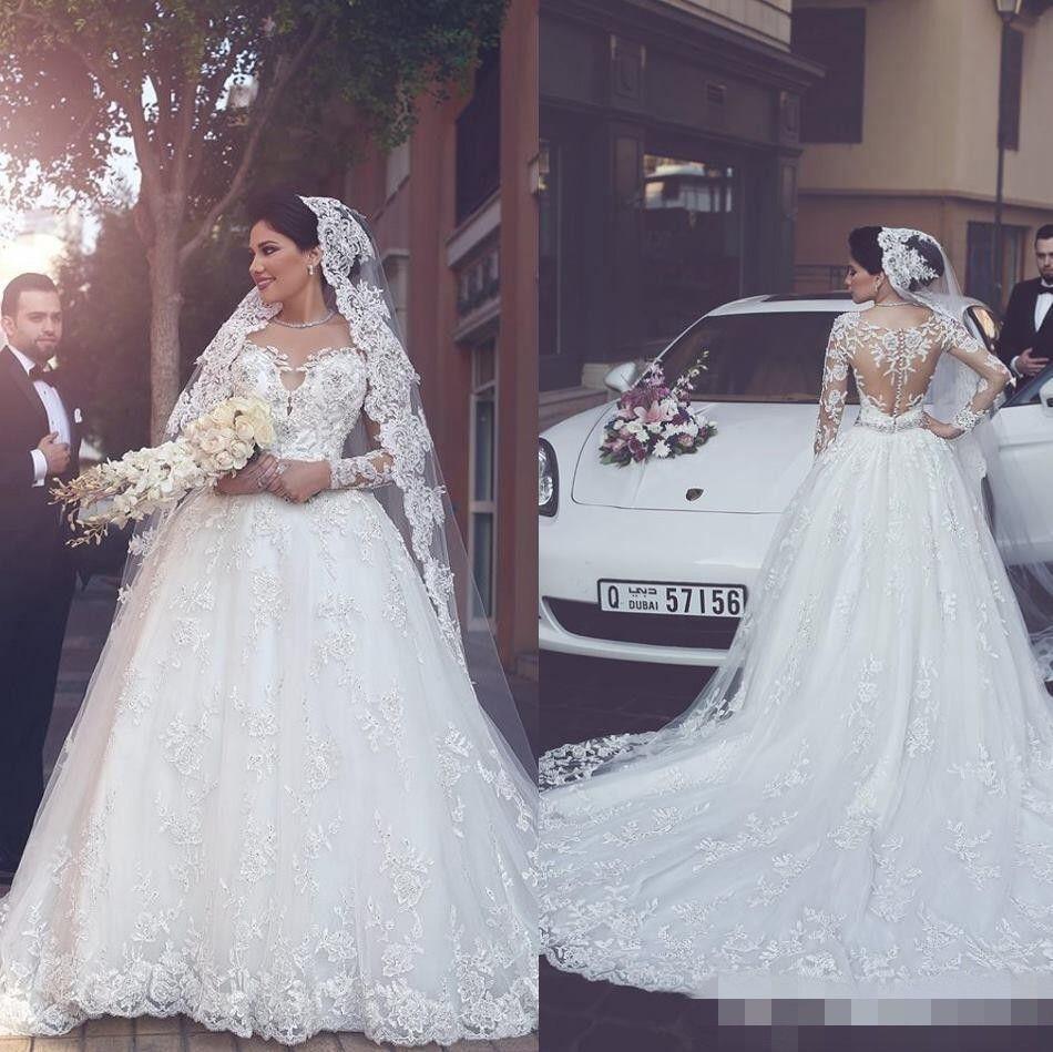 Discount Luxurious 2018 Dubai Long Sleeves A Line Wedding Dresses Bridal  Gowns Sheer Crew Neck Lace Appliques Beaded Vestios De Novia With Buttons  Indian ... b1c7ff7d43ce