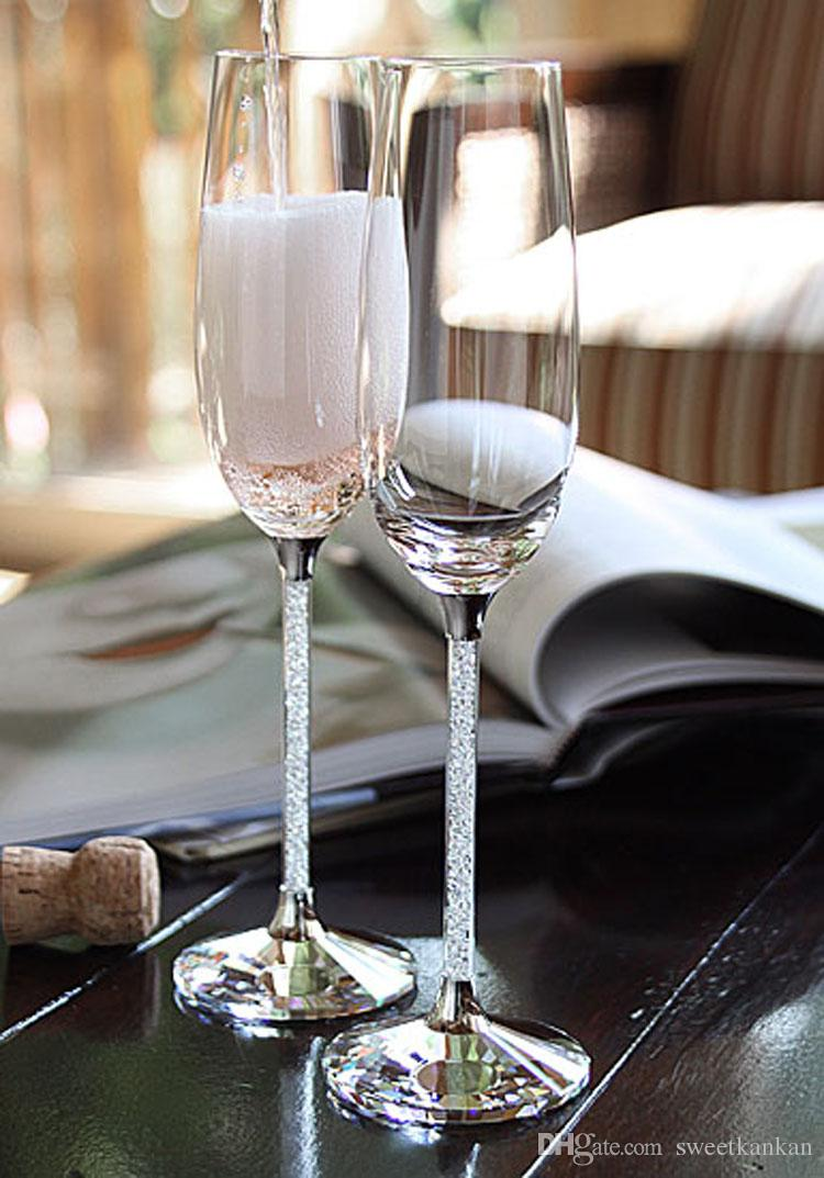 Crystalline champagne glasses toasting flutes in pair with crystal facet base and sparkle diamond stem as wedding gift