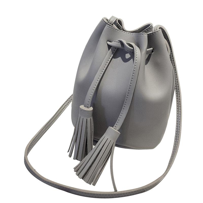 59734bebee23c New Style Tassel Shoulder Bags Girls PU Leather Retro Woman Crossbody Bags  Solid Color Fashion Drawstring Female Handbags On Sale Leather Bags From  Shuiyong ...