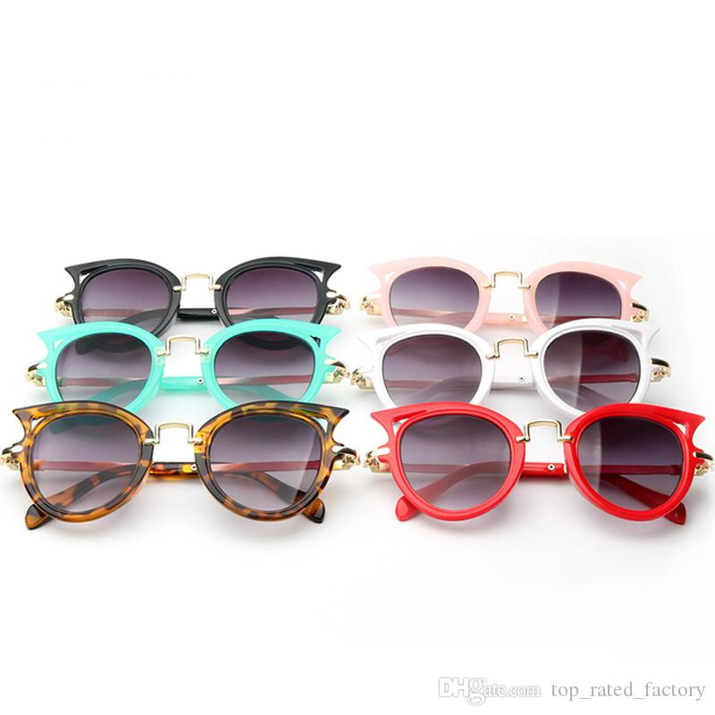 a5b113265db Kids Cat Eye Anti UV Sunglasses Leopard Frame Brand Shades Glasses Candy  Color Celebrity Party Eyewear Cute Girls Boys Online with  3.21 Piece on ...