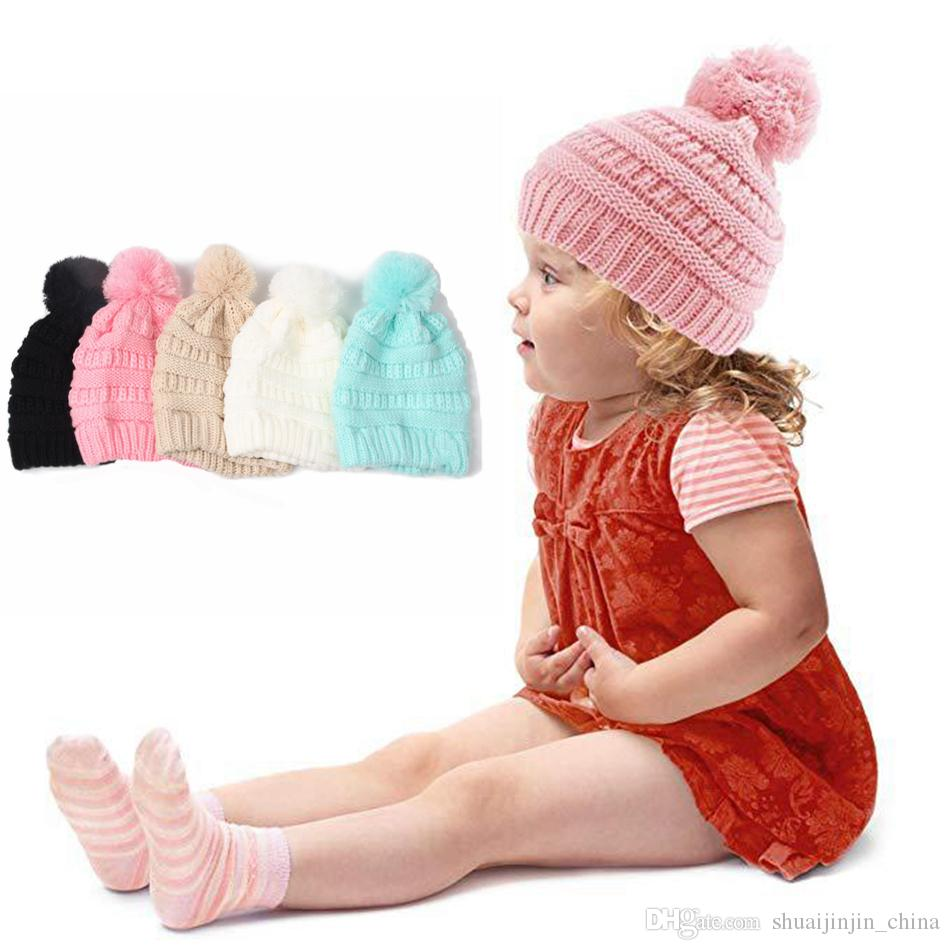 7a168f8fe Kids Hats Pom Poms Beanie Trendy Knitted Chunky Skull Caps Winter Cable  Knit Slouchy Crochet Outdoor Hats 6 Colors 20pcs OOA3825