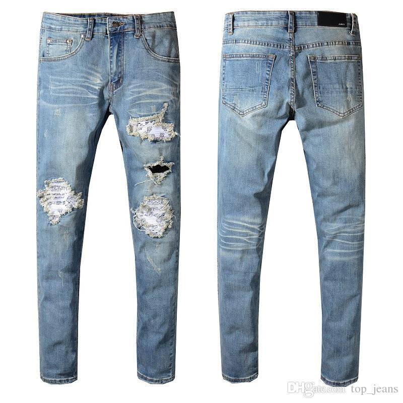 online store e30af b342f Jeans uomo Jeans strappati Pantaloni uomo blu Rock Star Designer tuta Denim  Pantaloni maschili Designer Denim Jeans skinny maschili