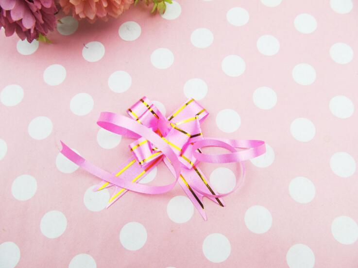Embalaje de regalo Cintas de arco de tiro 10 unids / lote Regalo de la boda Suministros de la fiesta de cumpleaños Decoración del hogar DIY Cintas de flores de tirón es