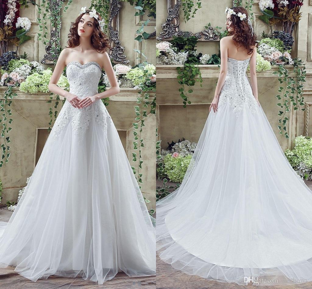 ab8a861e0c54 2018 vestidos de novia de encaje de marfil blanco barato una línea de tul  de encaje de lujo apliques perlas largo corsé espalda bajo vestidos de ...