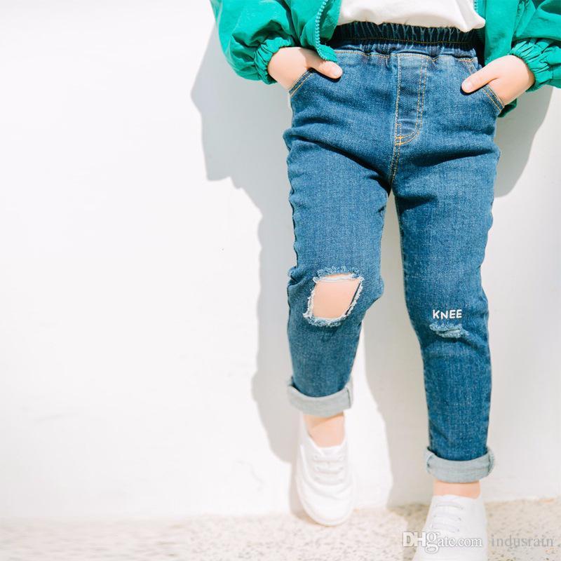 7f6d54841 Compre Meninos Meninas Jeans Rasgado Moda Infantil Denim Calça De