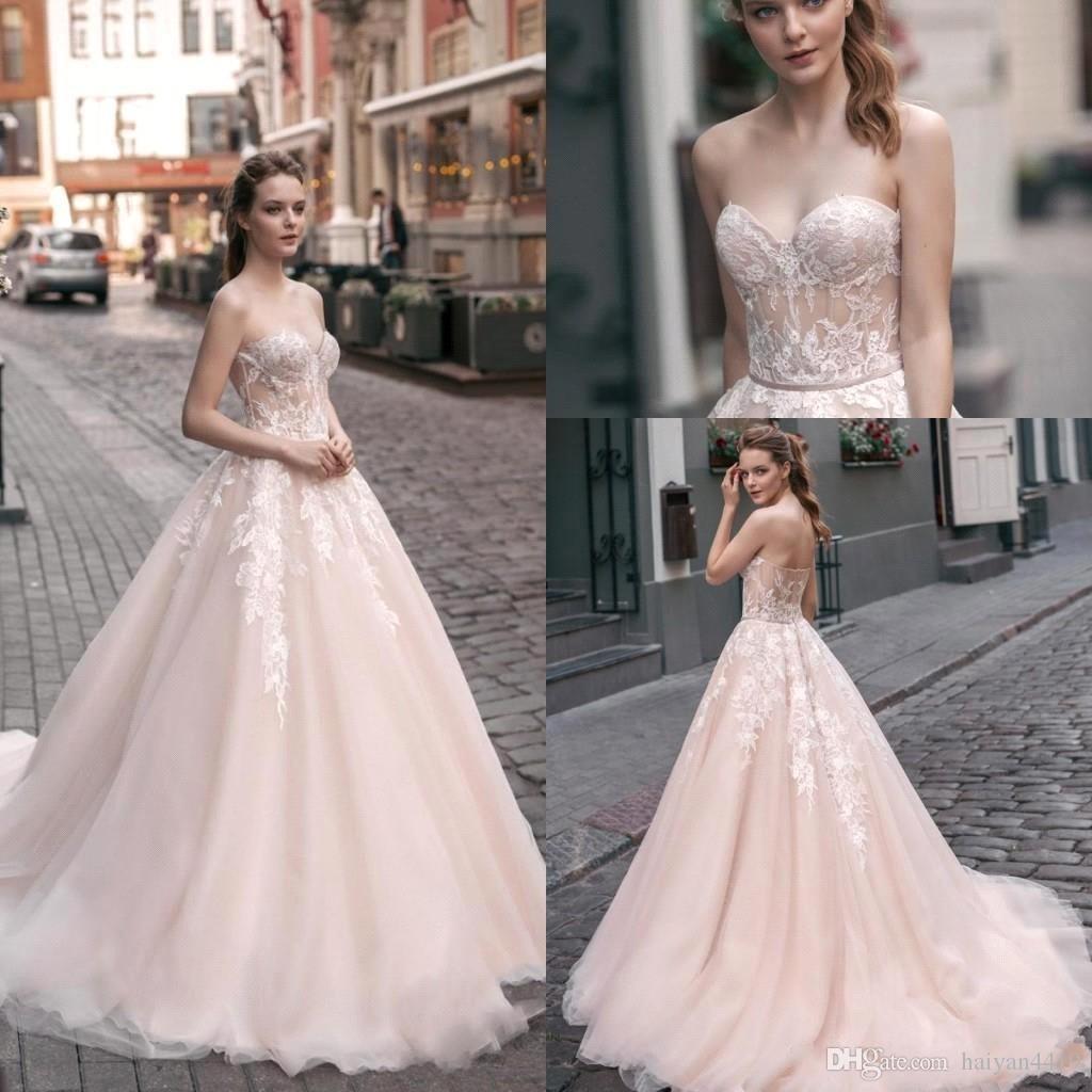 d55ec1afd70ef Discount 2018 Cheap A Line Wedding Dresses Sweetheart Illusion White Lace  Appliques Backless Blush Sweep Train Arabic Vestido Plus Size Bridal Gowns  Best A ...