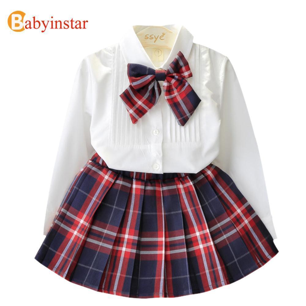 fa06a8bd704eb Compre Babyinstar Nuevo 2018 Ropa De Niñas Establece Camisas Blancas Con  Pajarita + Falda A Cuadros 2 Unids Ropa De Moda De Otoño Uniforme Escolar  De Las ...