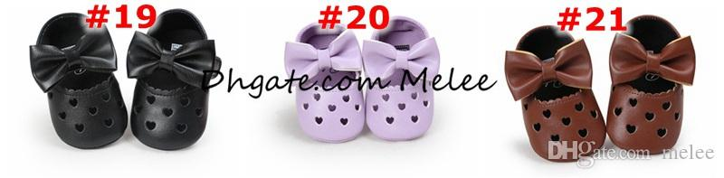 INS ES Elija mocasines del bebé amor corazón arco infantil Prewalker PU cuero niños hueco de zapatos para niños niñas suave antideslizante suela