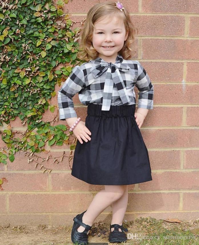 56c95d9eb INS niños pequeños trajes otoño nuevo bebé niñas a cuadros blanco negro con  cordones arcos corbatas camisetas tops faldas negras 2pcs conjuntos ...