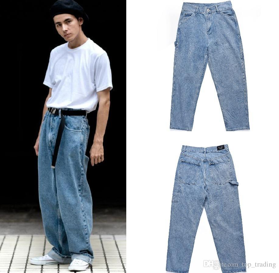 Compre Pantalones Vaqueros Holgados Para Hombres KANYE WEST Loose Denim  Style Diseñador De Moda Recta Hip Hop Streetwear Pantalones Para Hombre K25  A  62.95 ... d19e00cd603