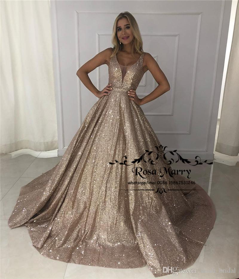Sparkly Gold Sequined Prom Dresses 2019 Ball Gown V Neck Backless Plus Size  Arabic African Girls Pageant Formal Evening Party Gowns Prom Dresses Sherri  Prom ... ef01015a3665