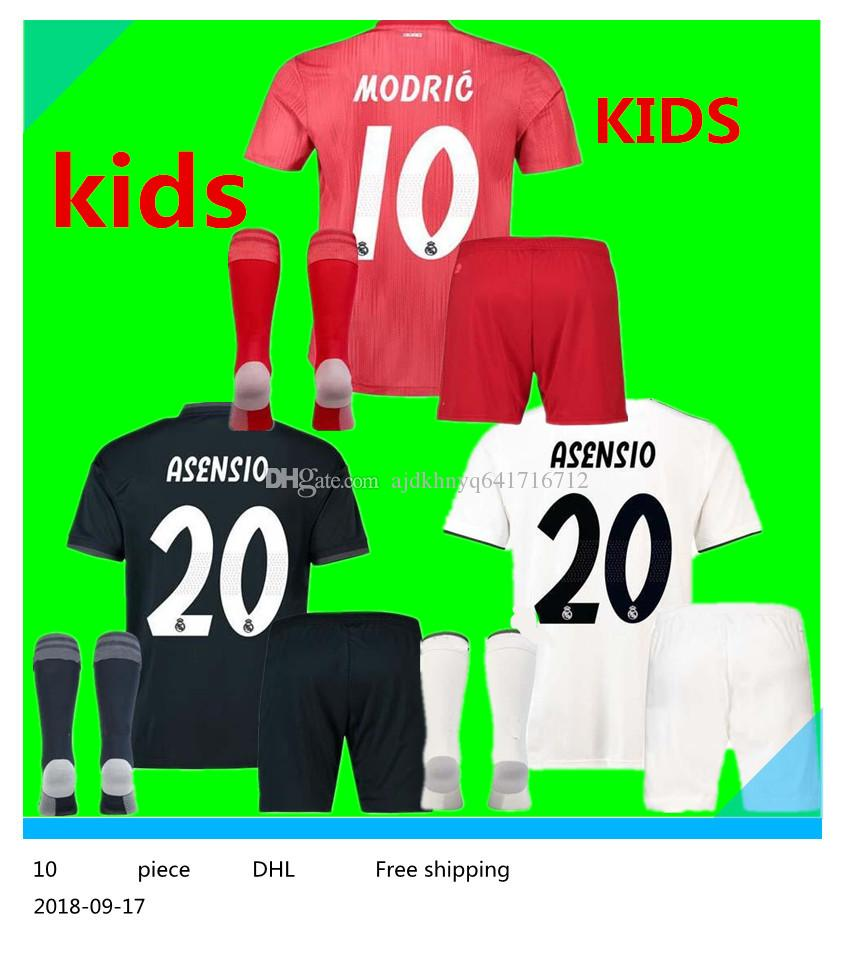 Compre 18 19 Real Madrid Niños Jersey De Fútbol Kits Niño Jerseys Tercero  RED 2019 2019 INICIO Asensio BALE RAMOS Camisetas De Fútbol AWAY ISCO  Casemiro A ... c19a5784f1c