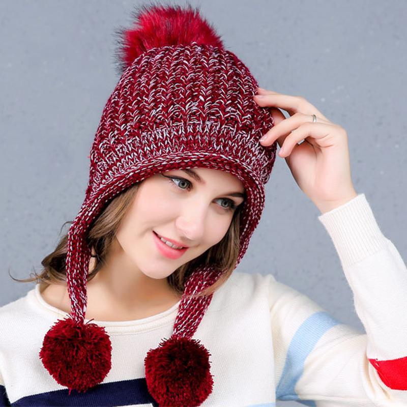 52bfb106365 2017 Warm Winter Hats For Women Wool Knitted Faux Fur Pompom Caps Earflap  Female Skullies Beanies Ladies Pom Pom Hats Bonnet Straw Hat Baseball Cap  From ...