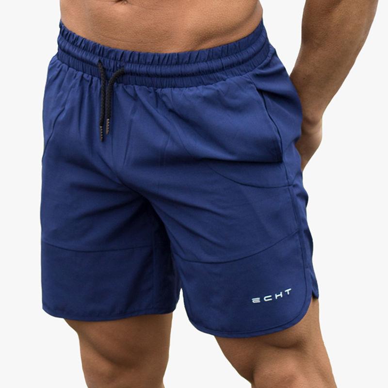 Compre 2018 Verano Nuevos Hombres Pantalones Cortos Flojos Culturismo  Pantalones De Chándal Hombre Moda Casual Beach Hombre Jogger Entrenamiento  Marca ... d20758a678ce