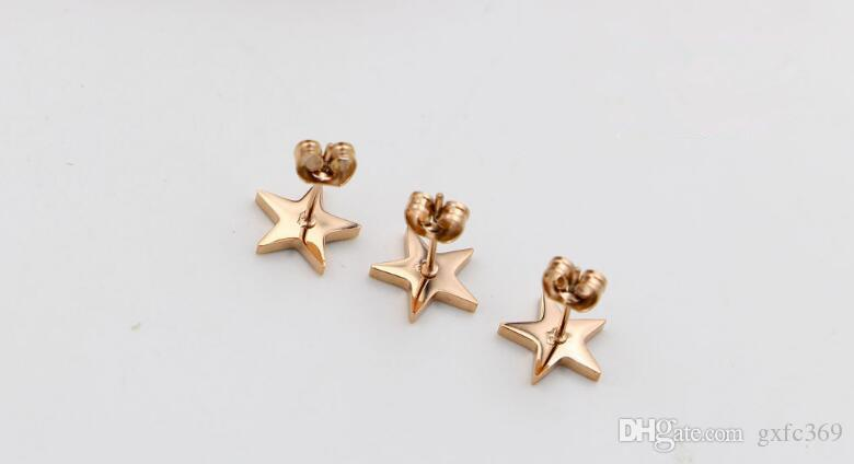 Orecchini coreani in oro rosa e acciaio di titanio di Dijiao in oro bianco e rosa