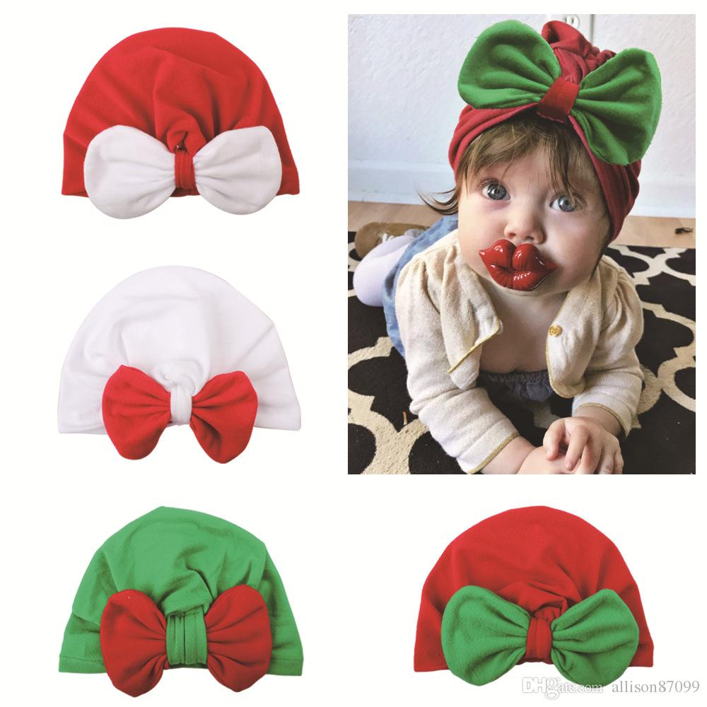 85ad3ebedc2 2019 2018 Christmas Baby Hat Accessories Ins Infants Cute Big Bow Contrast  Muslim Caps Maternity 2018 Fall Winter Cheap Price Wholesale From  Allison87099