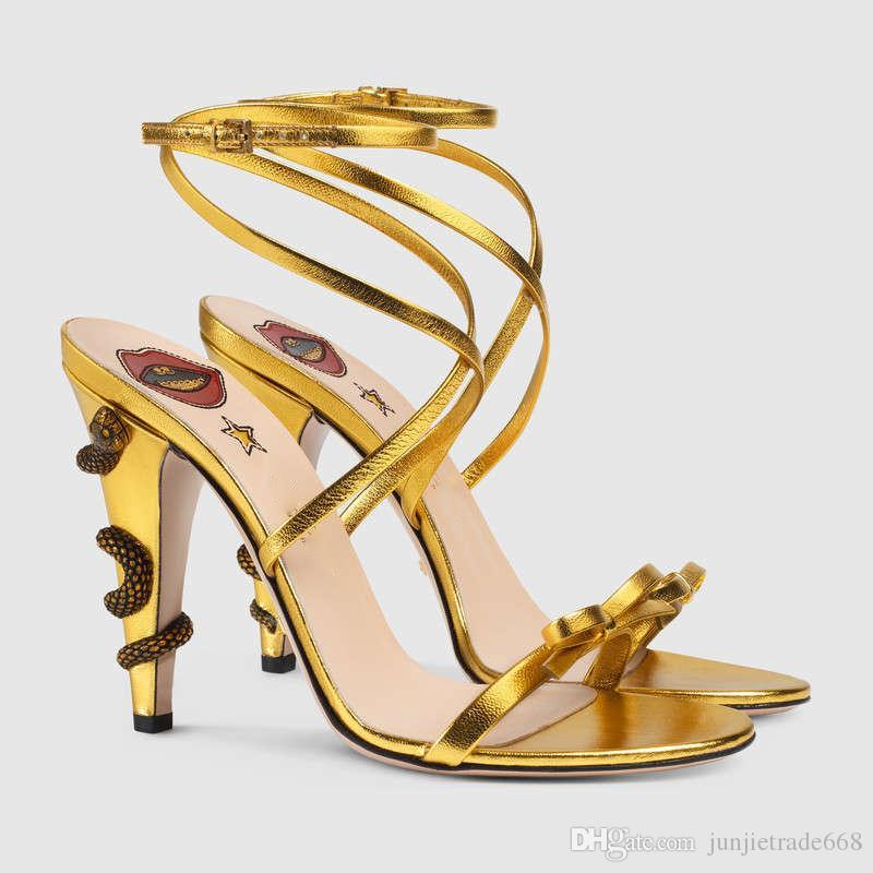 2018 modelos de pasarela nueva lista de zapatos de cuero genuino europeo y americano tacones de aguja tacones altos hebilla de serpiente correas cruzadas arco sandalias